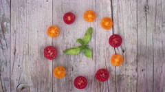Stop motion round dance of tomatoes on a flat lay Stock Footage