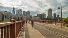 Minneapolis Skyline Stone Arch Bridge Time Lapse Logos Removed 4K 1080p Stock Footage