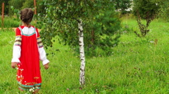 Eleven-year-old girl in a russian folk dress near a birch tree Stock Footage