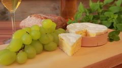 Camembert with white wine Stock Footage
