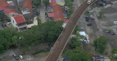 Bird eye view of poor district and riding train on railways. Bangkok, Thailand Stock Footage