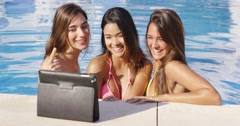 Three vivacious smiling women taking a selfie Stock Footage