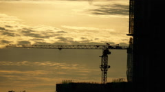 Tower crane on sunsets background. Stock Footage