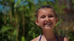 Girl with pigtails smiling at the camera Stock Footage