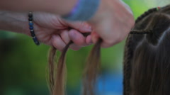 Closeup hand braided pigtails Stock Footage