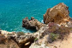 Atlantic rocky coast (Algarve, Portugal). Stock Photos
