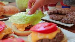 Hands put fresh leaf lettuce Stock Footage