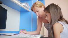 Girl doing homework together with her mother. Girl makes lessons Stock Footage