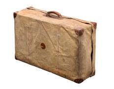 Isolated Old Vintage Dusty Suitcase in a cover on a white background Stock Photos