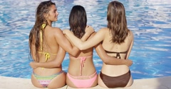 Three sexy shapely women in bikinis from the rear Stock Footage