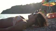 Curly Girl on a Beach on Her Mobile Phone 4K Stock Footage