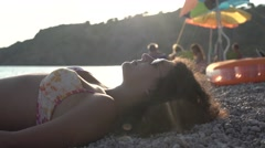 Curly Girl on a Beach Relaxing with her iPhone 4K Stock Footage