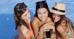 Three beautiful sexy young girlfriends Stock Footage