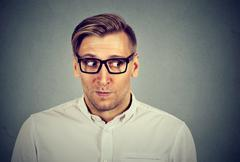 Preoccupied worried man in unpleasant, awkward situation Stock Photos