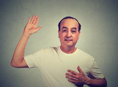 Middle aged man making a promise Stock Photos