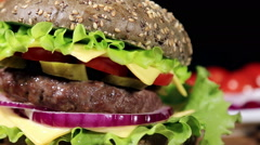 Beef burger meal on a bun with squid Stock Footage