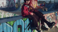 4k Colourful Shot of a two Young People Talking and having fun in Skatepark Stock Footage