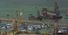 Aerial view of dock when contained barge with sand by crane. Hong Kong, China Stock Footage