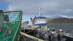 Fishing boat and fishermen in the port - Honningsvag landscape, Norway  Stock Footage