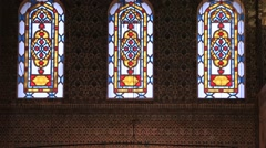 Rows of stained-glass windows in the old building Stock Footage