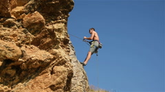 Climber Doing Down The Rope From A Cliff Stock Footage