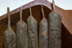Hand made marijuana joints on wooden platter Stock Photos