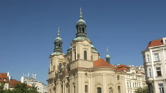 Pan from Nicholas Church to Jan Husa Prague Stock Footage