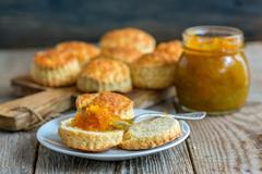 Scone with homemade orange jam. Stock Photos