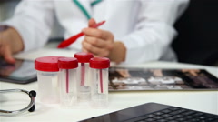 Doctor Sitting In Clinic And Working On Tablet. Stock Footage