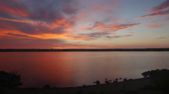 Dramatic Red Sky Over Lake Stock Footage