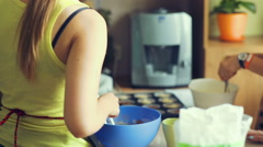 Female cook put cupcakes to oven Stock Footage