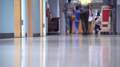 Visitors and medical professionals in a medical wing Stock Footage