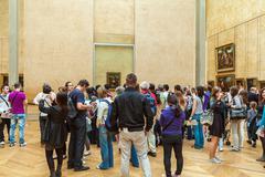 PARIS, FRANCE - APRIL 8, 2011: Students walking inside the Louvre Museum near Stock Photos