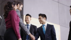 4K Business teams greet each other & shake hands in modern office building Stock Footage