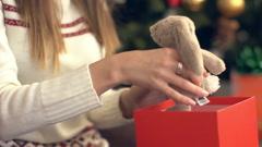 Beautiful smiling girl open christmas gift Stock Footage