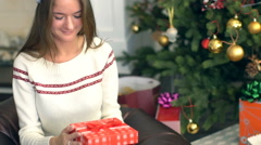 Pretty smiling girl open christmas gift Stock Footage