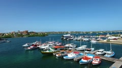 Aerial of fishing boats docked in marina on Curacao Stock Footage