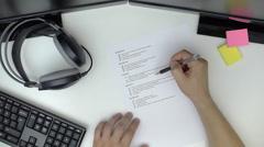 Businessman preparing checklist at office desk Stock Footage