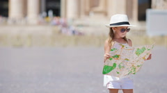 Adorable little girl with touristic map in St. Peter's Basilica square, Italy Stock Footage