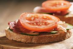 Ciabatta open sandwiches with speck and vegetables Stock Photos