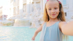 Adorable little girl taking selfie background Trevi Fountain, Rome, Italy. Happy Stock Footage