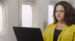Woman on an airplane using her laptop Stock Footage