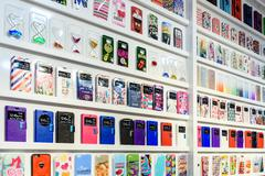 VALENCIA, SPAIN - JULY 23, 2016: Colorful iPhone And Samsung Phone Cases For  Kuvituskuvat