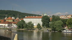 Manes Bridge and Vltava River with Prague castle Stock Footage