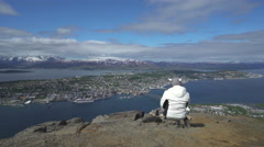 Tromso panoramic view - foreground a girl, Norway Stock Footage