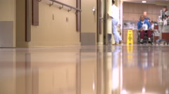 Patient is wheeled down a hall Stock Footage