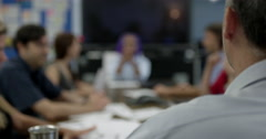 Sharp focus man in foreground attending soft focus business meeting 4K Stock Footage