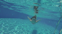 The girl swimming under the water Stock Footage