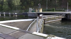 Sodertalje lock upper gates letting the canal water in to lock out ships Stock Footage