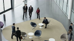 4K Diverse business group in meeting area of large modern office building Stock Footage